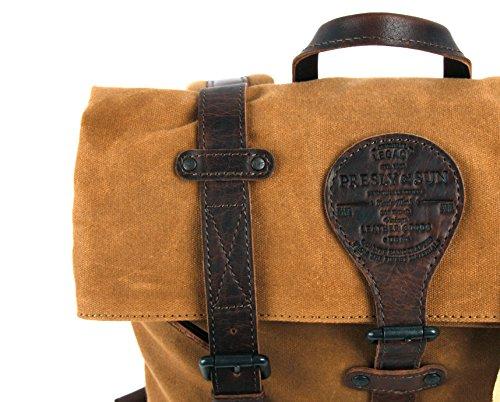 Génial contraste de matières et couleurs pour ce sac à dos en cuir et toile canevas, avec compartiment rembourré pour Laptop, Presly & Sun, Idéal pour les déplacements à vélo.
